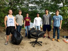 Members of the Men's Swim team cleaning up!