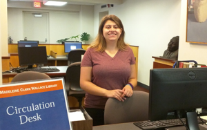 Student employee helping another student at the Wallace Library Information Desk