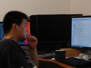 Cheng Zhang '18 (software lead) going over changes that the software group has submitted to him.